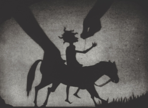 Testimony (Figure on a horse with hands controlling the puppet)