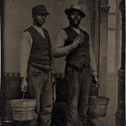 Two Black Men Wearing Vests and Holding Buckets, Late 1800s - early 1900s