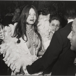 Woman in White Feathered Dress
