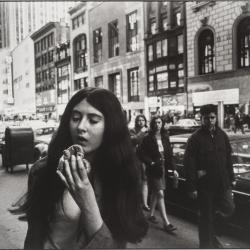 Young Woman Eating a Pretzel,